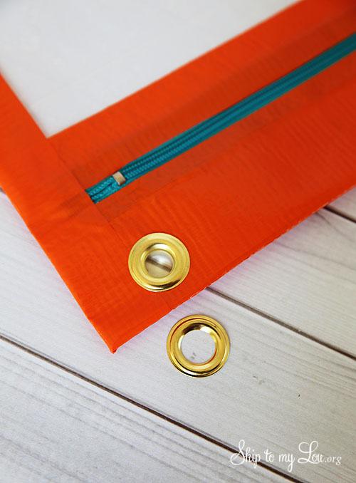 duct tape pencil bag grommet step 1