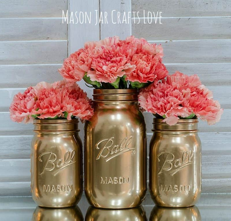 gold spray painted mason jars with coral flowers