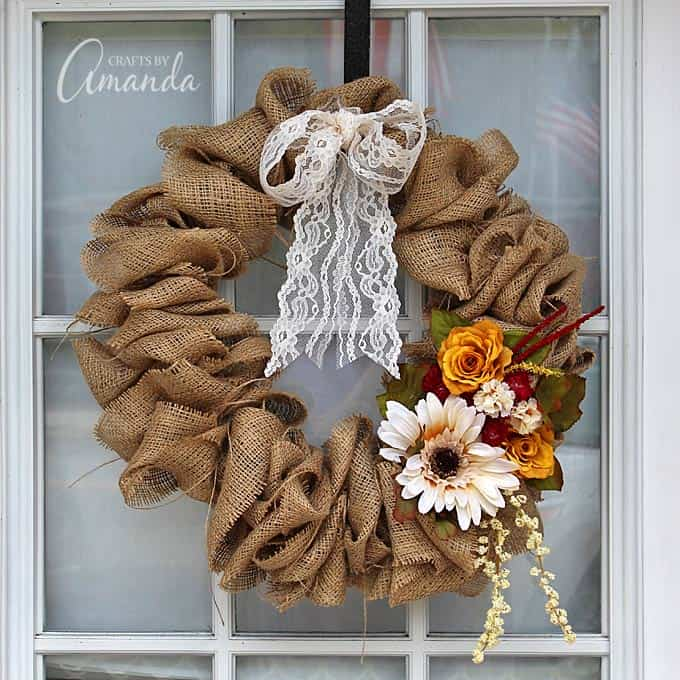 fall burlap wreath with lace and flowers on glass paned door