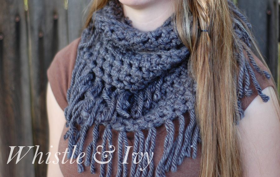 A charcoal gray Simple Chunky Fringe Crochet Scarf draped around a girl's neck