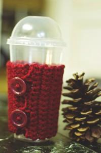 red crochet coffee cozy