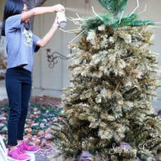 bella-spray-painting-christmas-tree-gold.jpg