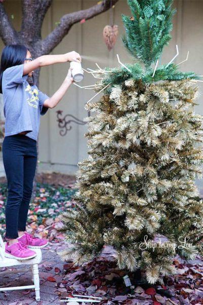 bella-spray-painting-christmas-tree-gold.jpg