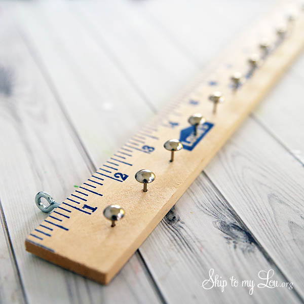 furniture nails in yardstick for advent calendar