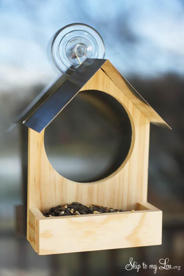 DIY wooden birdfeeder with watching hole