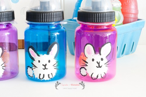 Close up of hand-apinted bunnies on water bottles from cupcakesandcrinoline.com