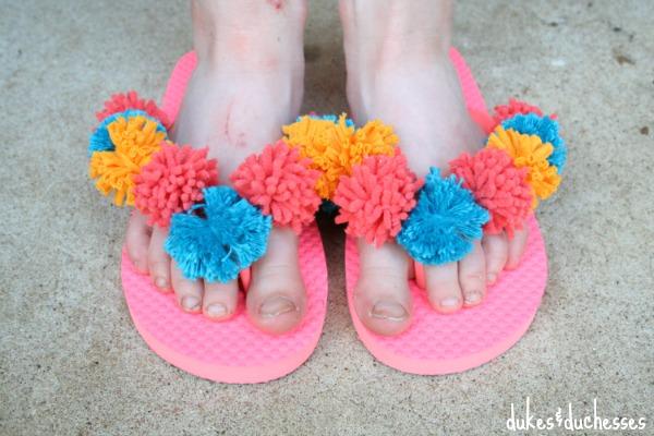 bright pom pom flip flops