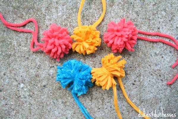 bright yarn pom poms