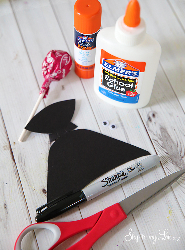 craft supplies: glue, glue stick, tootsie pop,  dracula template, googly eyes