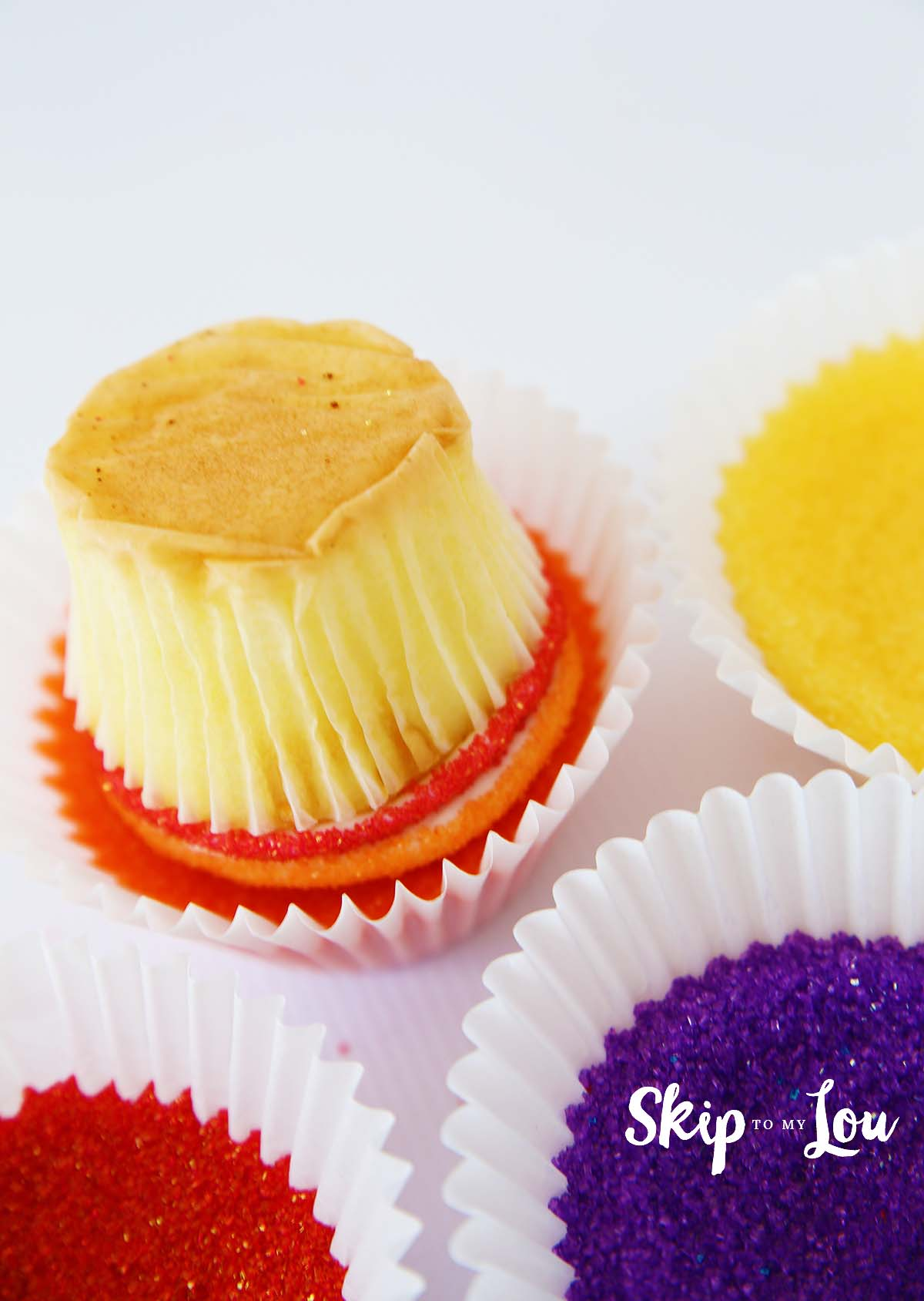 sanding sugar dipped rainbow cupcakes