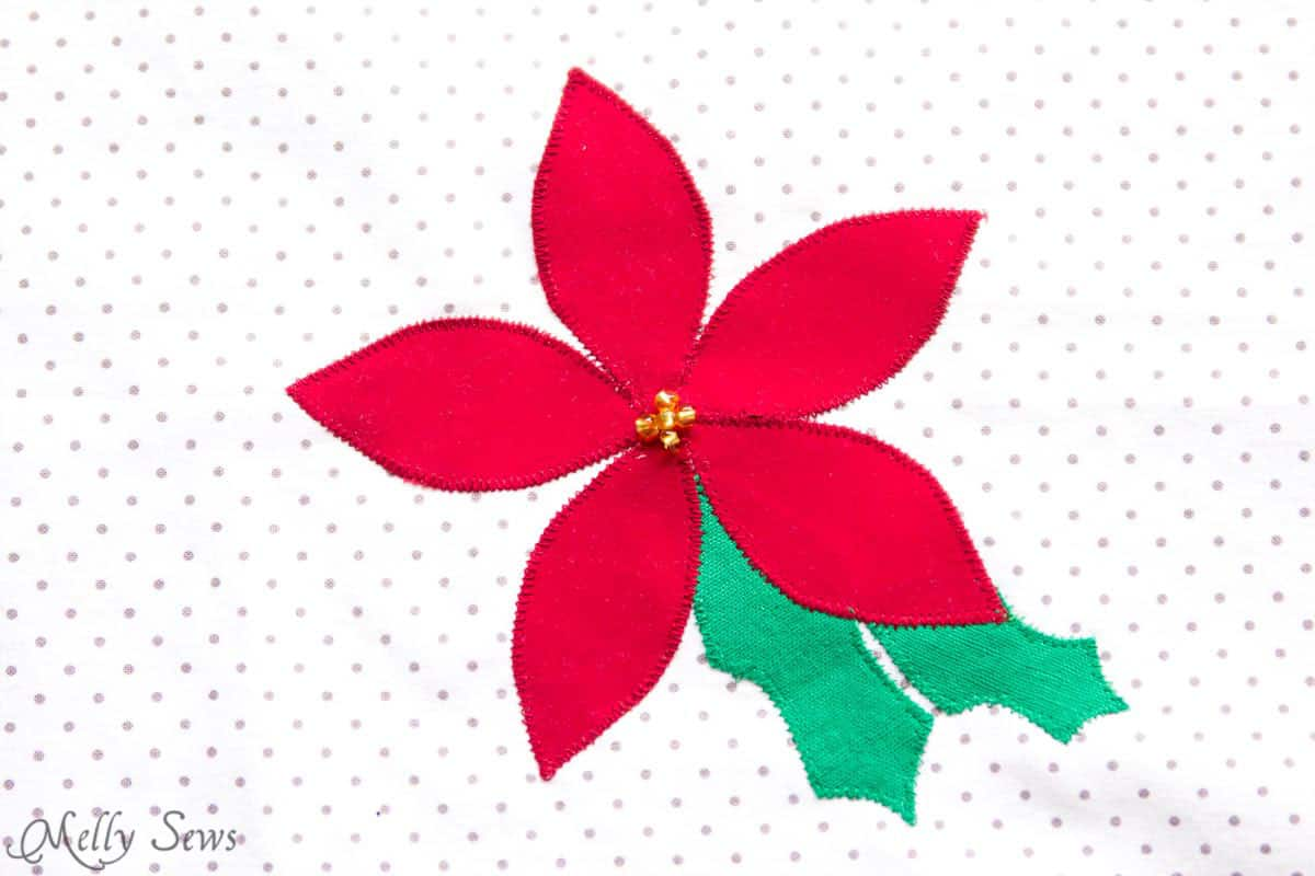 Poinsettia appliqué - sew reusable gift bags and use up your scraps! Sewing tutorial by Melly Sews