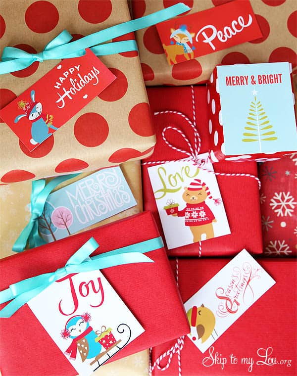 red packages wrapped with colorful printed christmas tags