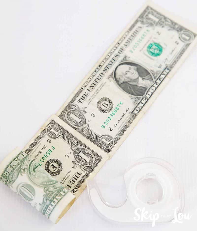 tape money together