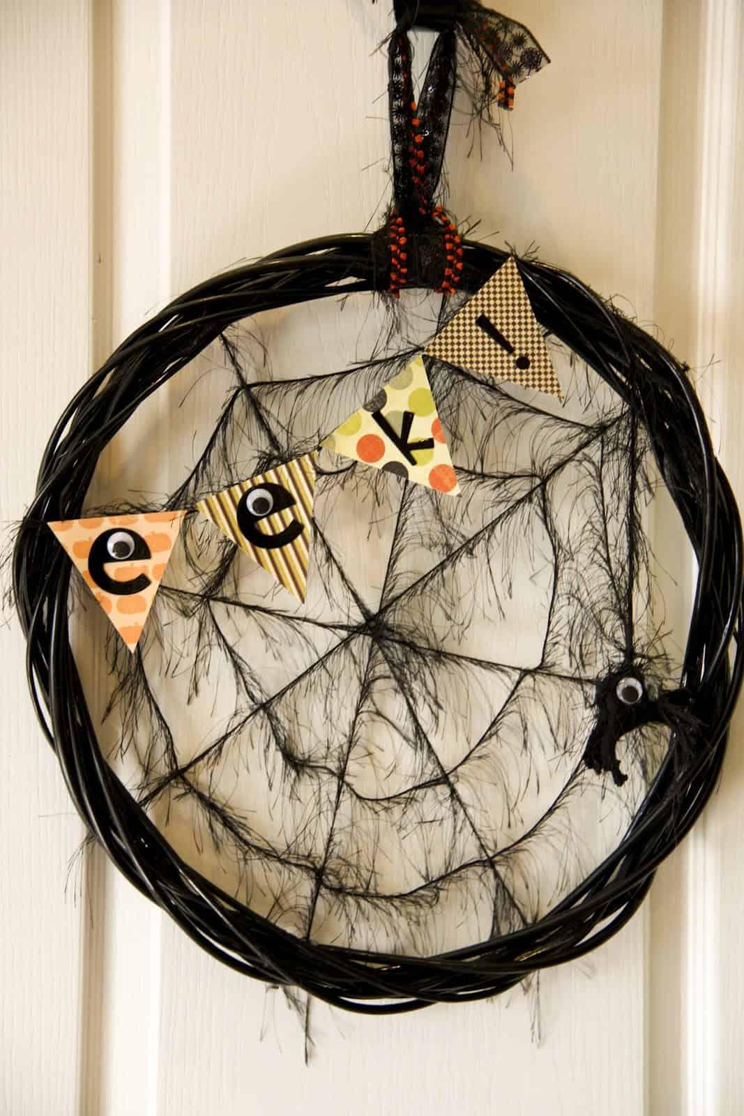 Black spider web with eek! sign door Halloween decoration