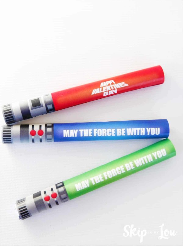 three packages of smarties covered with lightsaber printable valentines