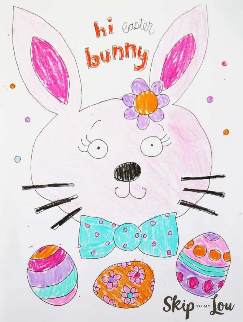 """coloring sheet with a bunny head with a flower on it and wearing a bow ties and three easter eggs below it; words on the page say, """"hi easter bunny"""""""