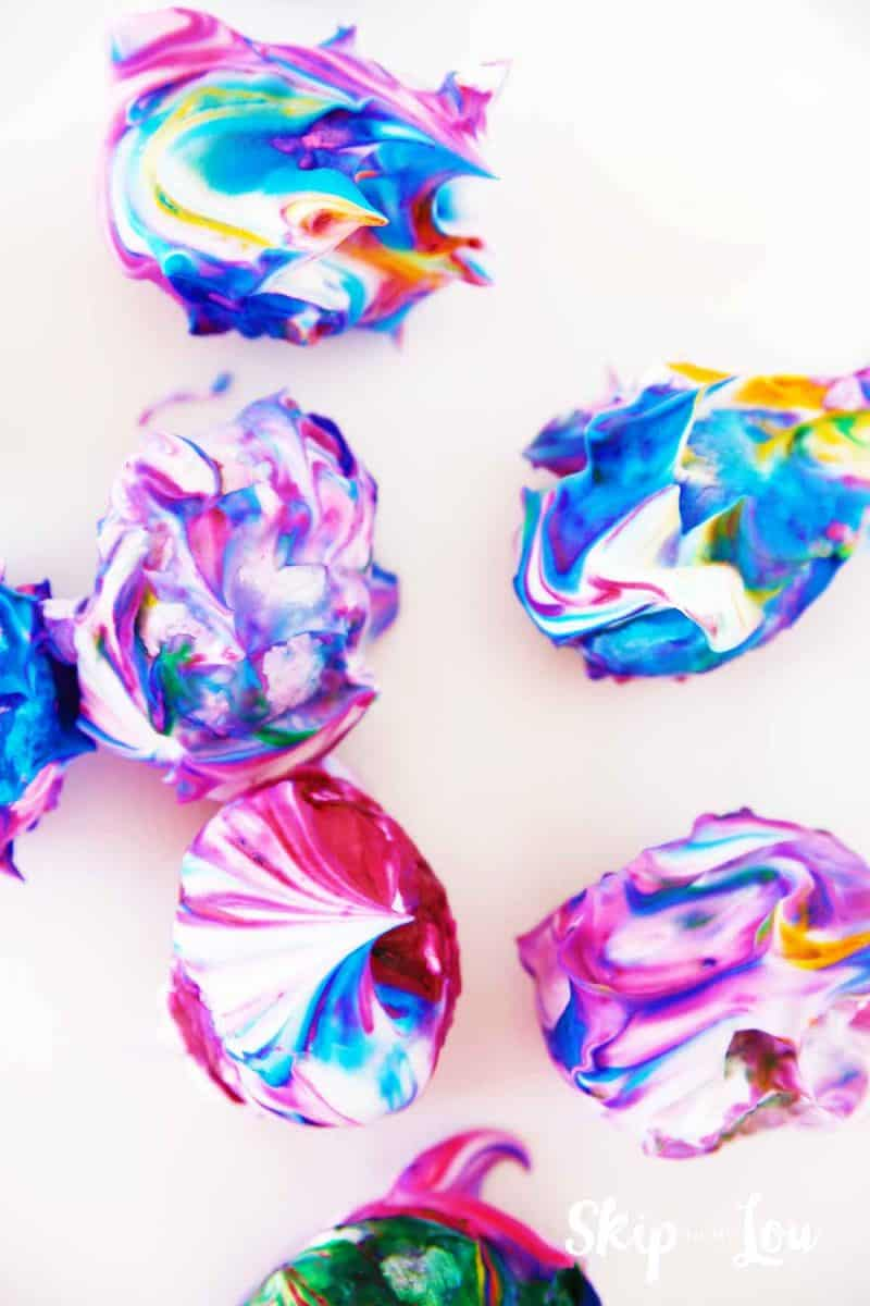 eggs covered in food coloring and shaving cream