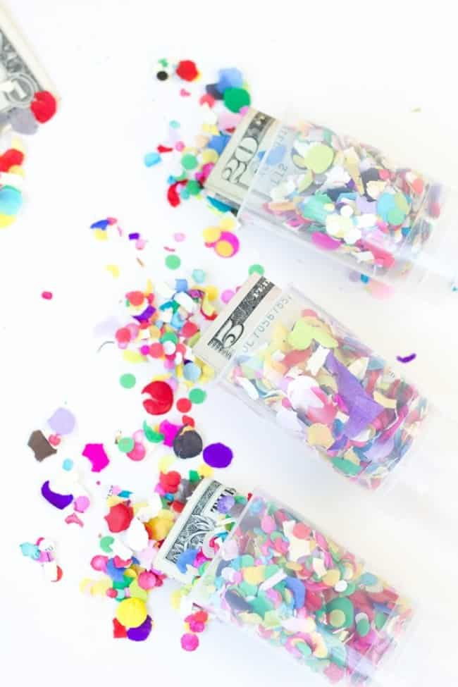 money and confetti in plastic push pops