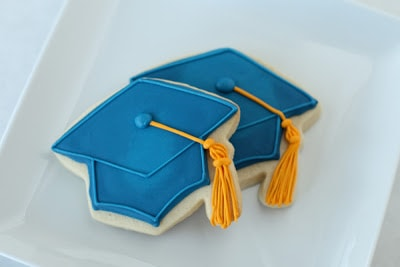 blue graduation cap cookies on a hat
