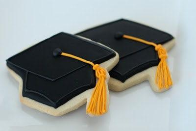 two black graduation cap cookies