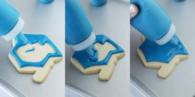 step by step how to decorate graduation hat cookies