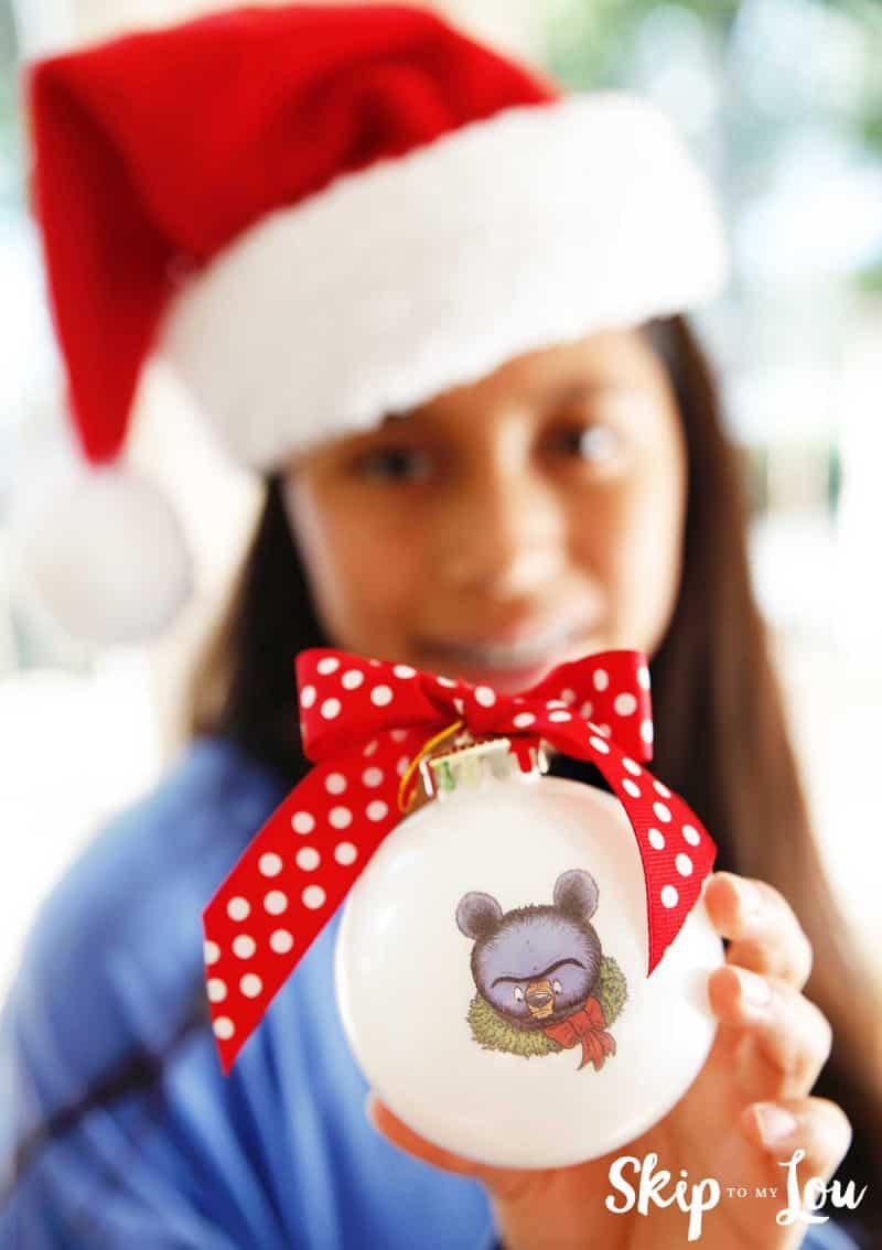 child holding santa bruce ornament