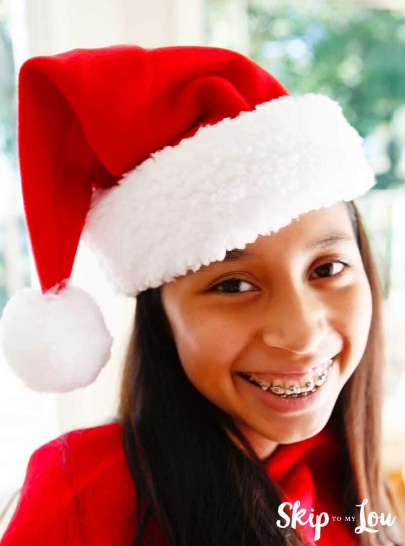 child wearing santa hat