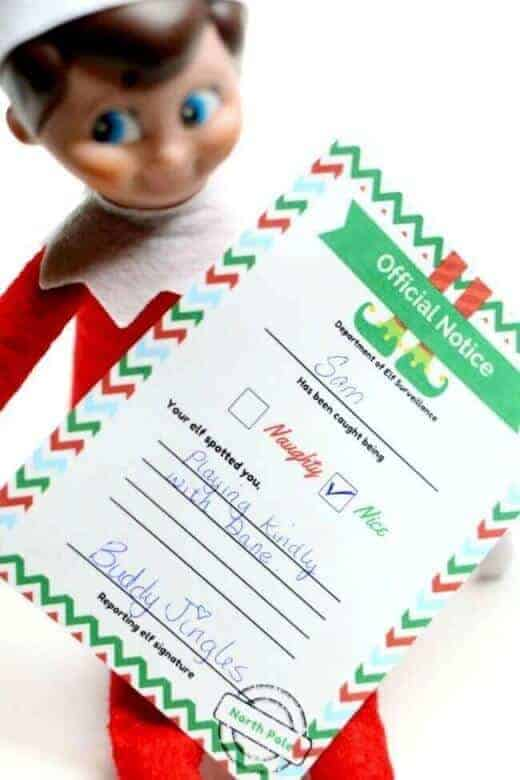 elf on the shelf letter held by elf
