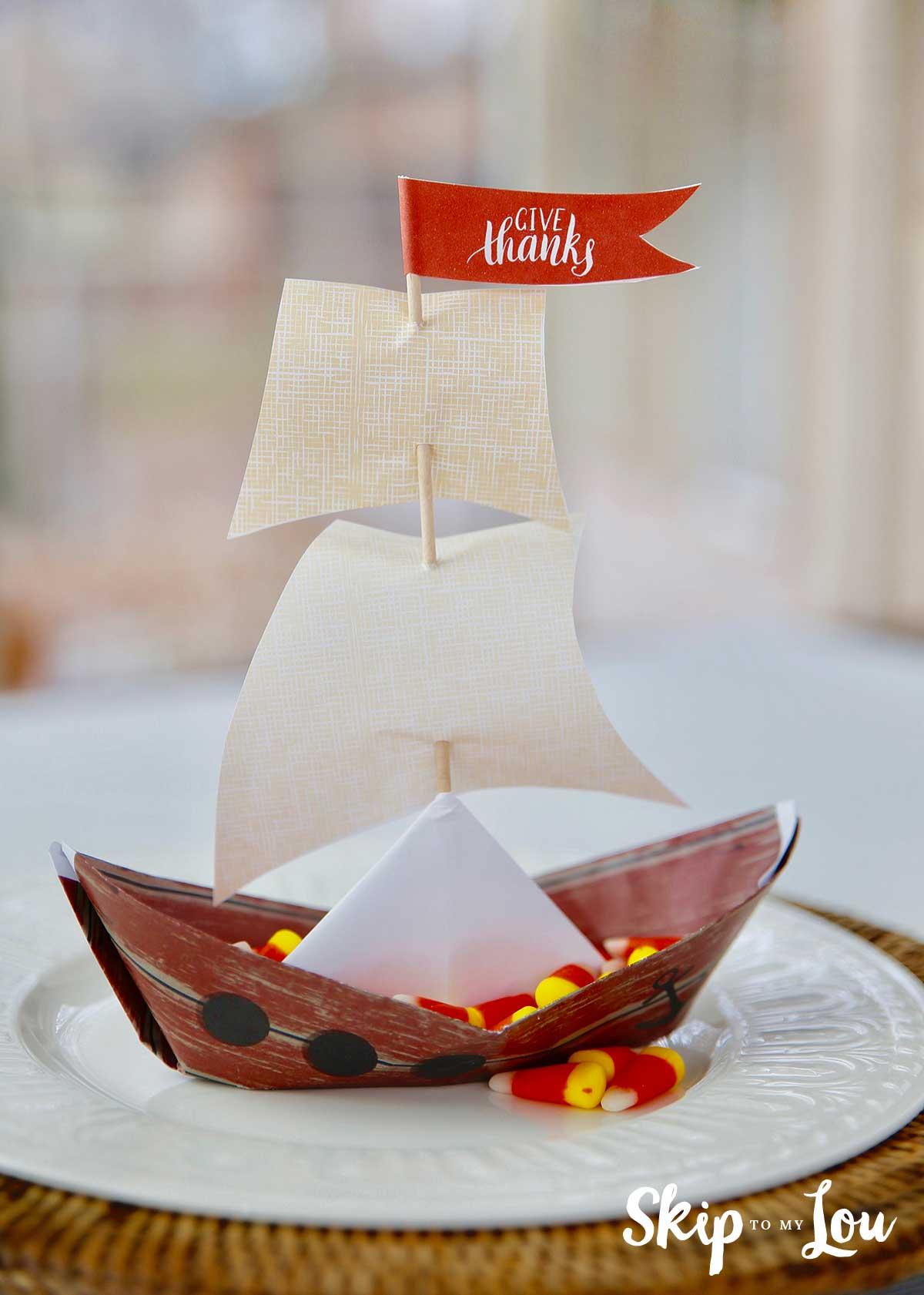 paper origami mayflower ship on white plate