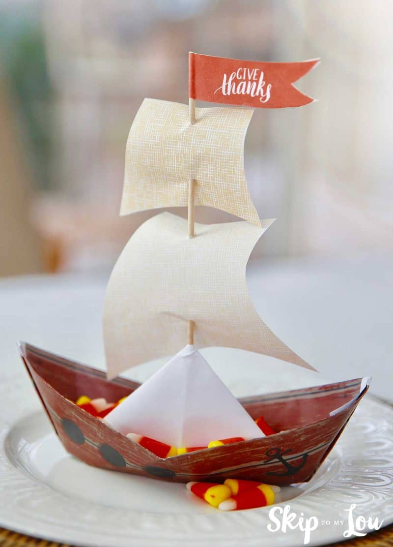 paper mayflower ship sitting on white plate
