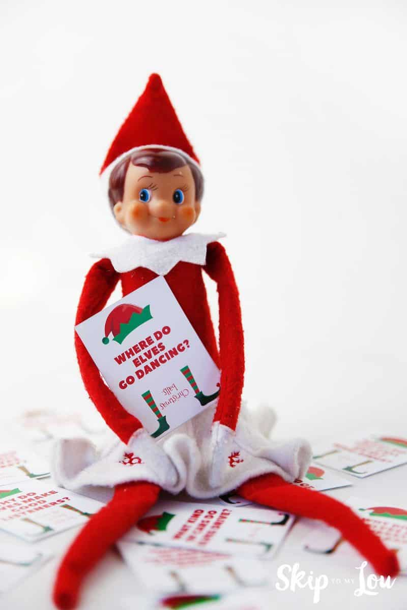elf on the shelf holding and sitting around printed elf jokes