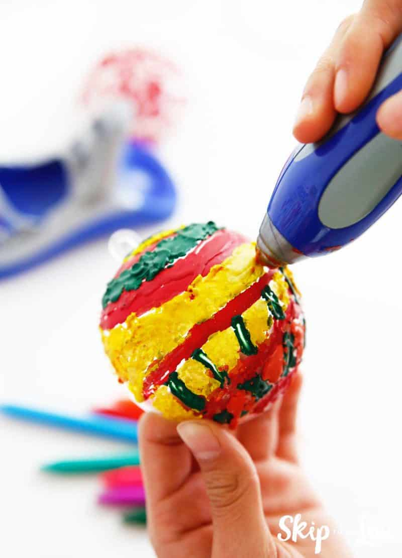 painting plastic ball ornament with melted crayon