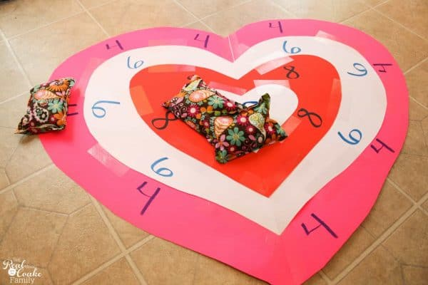 Valentine's Day bean bag toss, four tears of hearts with points in each layer with three bean bags