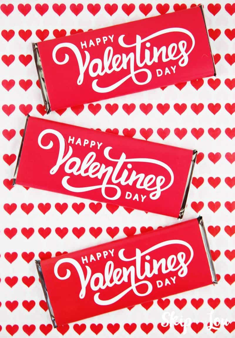 Valentine candy bar wrappers on hear background