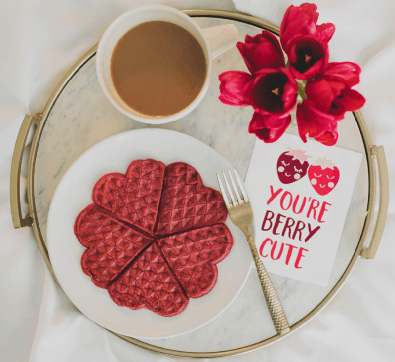 red heart shaped waffles on round tray