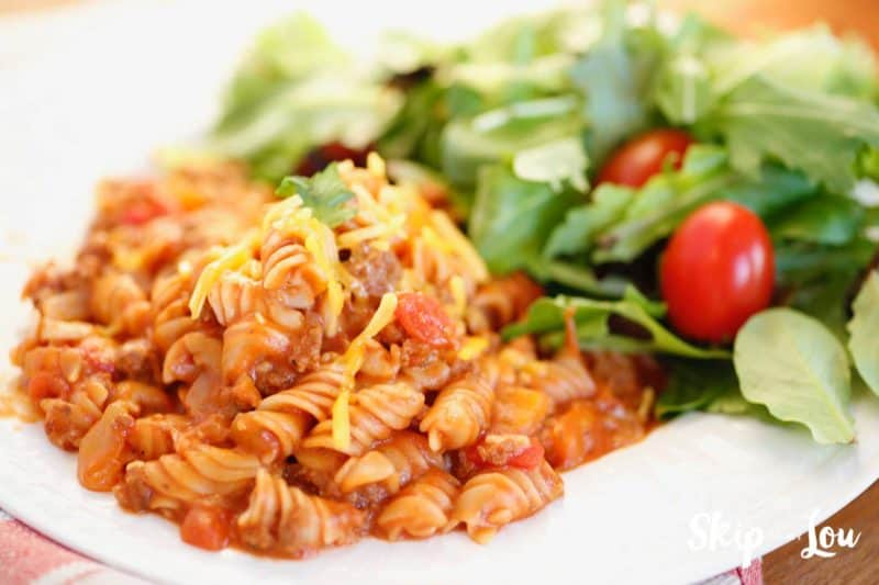 goulash on plate with salad