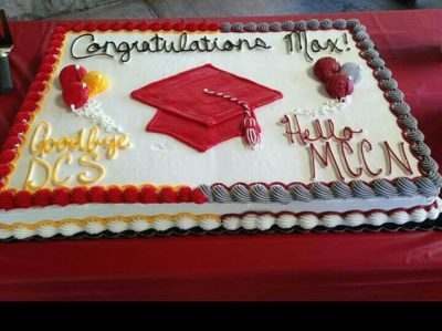 sheet cake with high school on one side and college on other