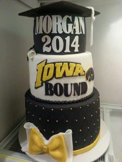 tierd cake that says grad name then Iowa bound
