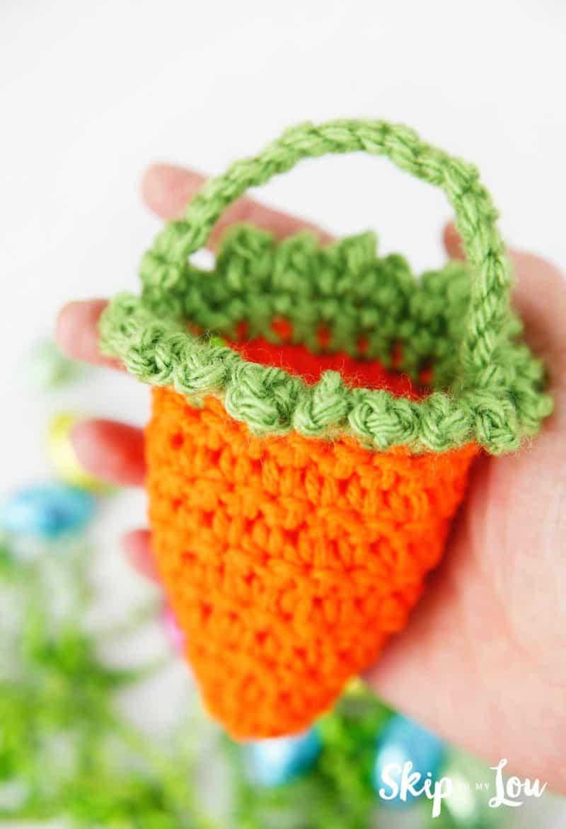 hand holding crochet carrot basket