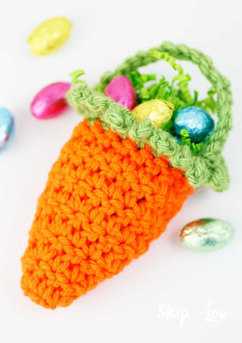 crochet carrot basket filled with chocolate eggs