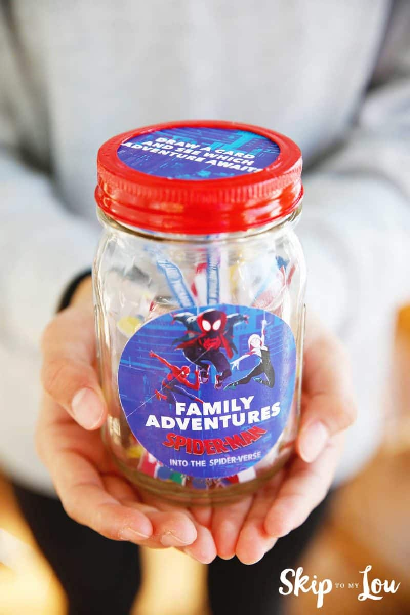 hands holding family adventure jar