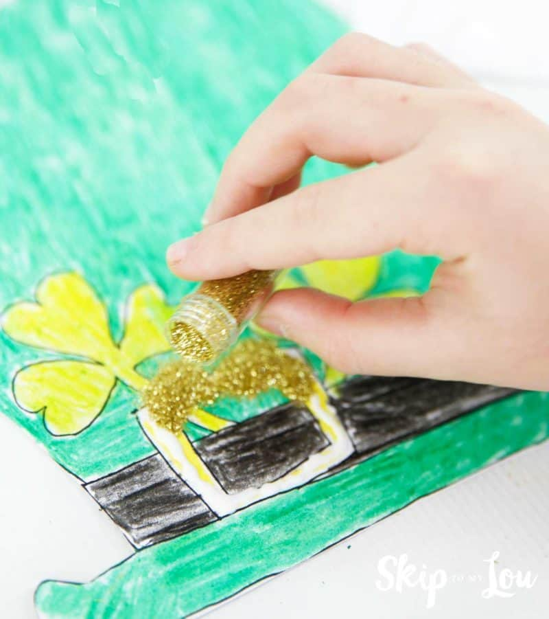 adding glitter to leprechaun mask