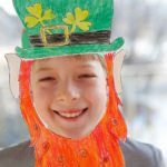 boy wearing leprechaun mask
