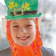 boy wearing leprechaun mask