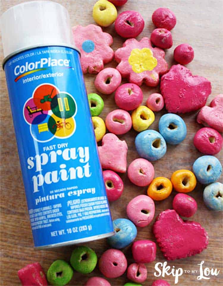 painted salt dough beads with can of clear spray paint