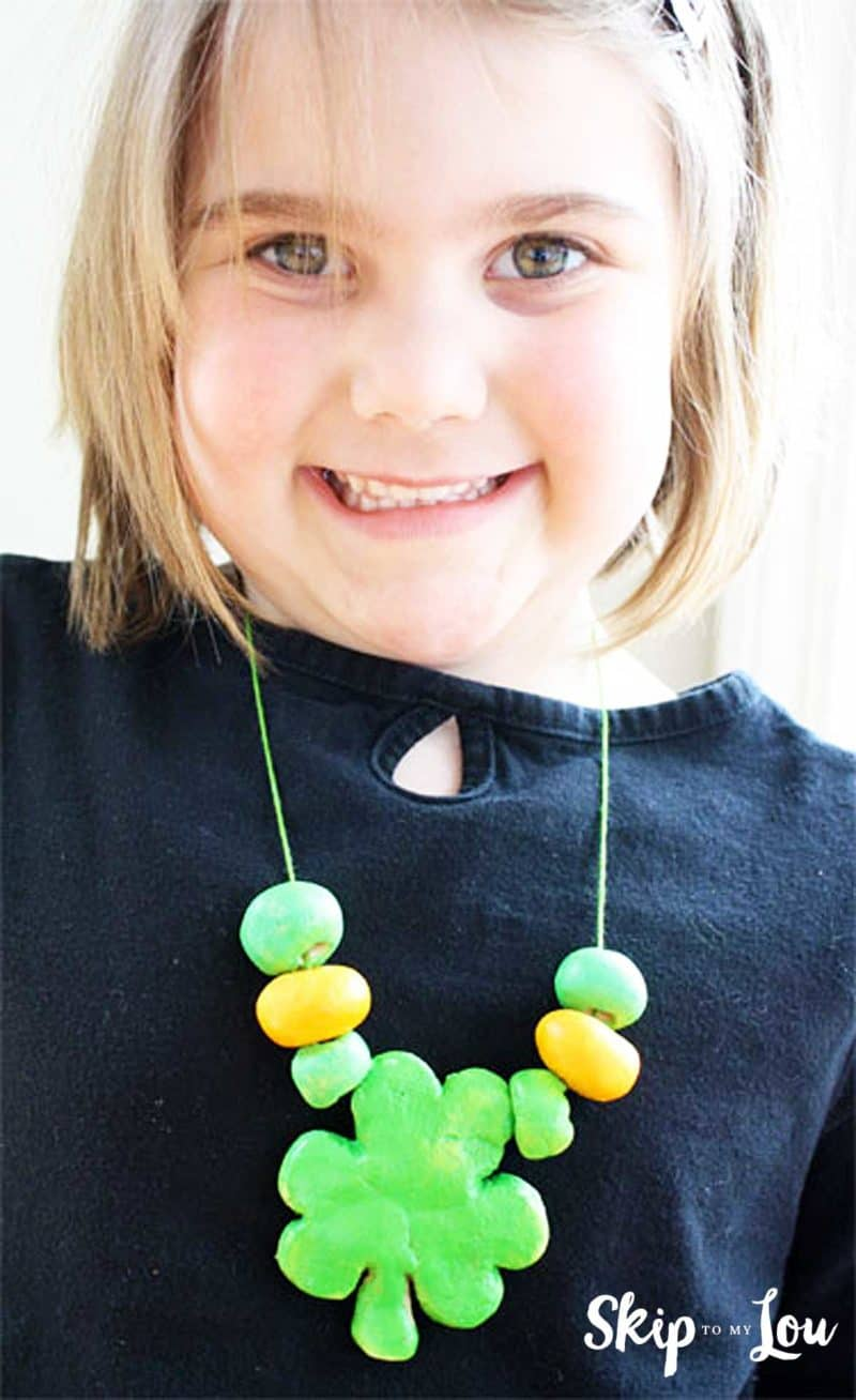 child wearing salt dough bead necklace