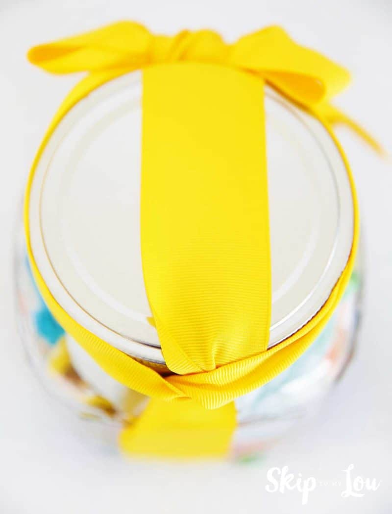 jar with yellow ribbon showing how to tie