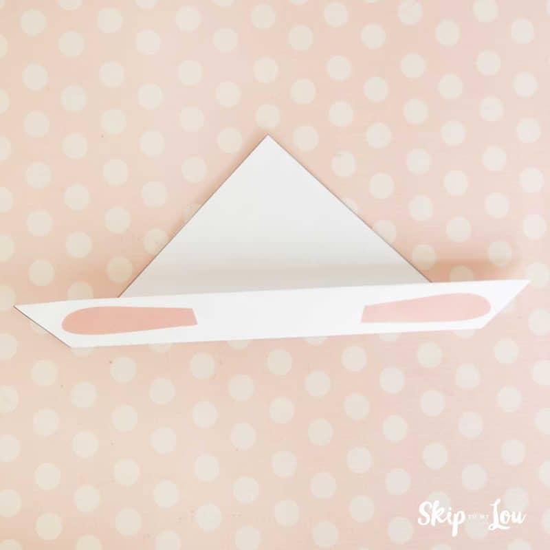 flip over paper folding up ear