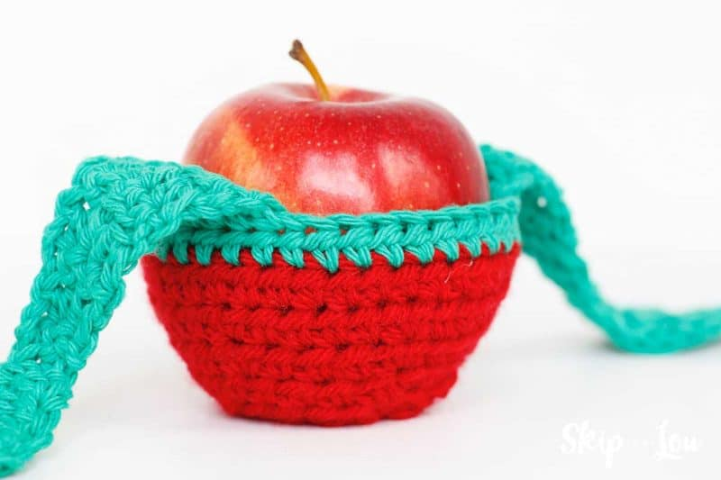 apple sitting in cozy with open leaf tie