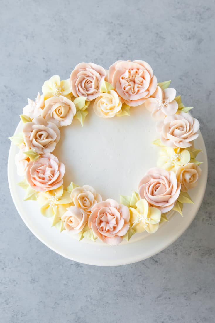 white cake with pastel buttercream flowers